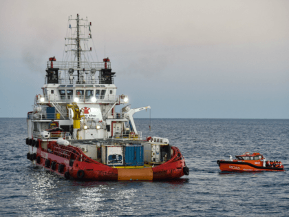 Migrants and refugees are transferred from the Topaz Responder ship run by Maltese NGO 'Moas' and the Italian Red Cross to the Vos Hestia ship run by NGO 'Save the Children', on November 4, 2016, a day after a rescue operation off the Libyan coast in the Mediterranean Sea.