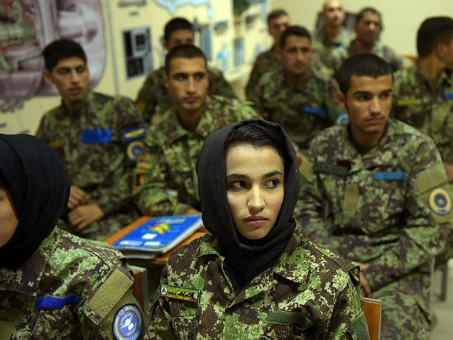 In this photograph taken on September 29, 2016, new Afghan air force pilots attend a class at the air force university in Kabul. Under pressure from the Taliban, Afghanistan's military is increasingly relying on the country's young air force, and, together with Western allies, is speeding up its training of pilots and ground controllers in order to strike the enemy. / AFP / SHAH MARAI (Photo credit should read SHAH MARAI/AFP/Getty Images)