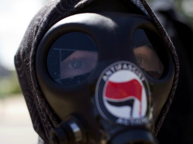 An Antifa demonstrator participates in the Denver March Against Sharia Law in Denver, Colorado on June 10, 2017. The march was supported by two right-wing groups, The Proud Boys, and Bikers Against Radical Islam. Police kept the counter protestors separated during the rally which was held in front of the …