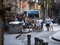 People flee from the scene after a white van jumped the sidewalk in the historic Las Ramblas district of Barcelona, Spain, crashing into a summer crowd of residents and tourists Thursday, Aug. 17, 2017. According to witnesses the white van swerved from side to side as it plowed into tourists …