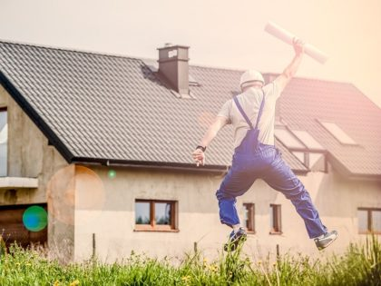 Stock photo: Construction worker jumps for joy.