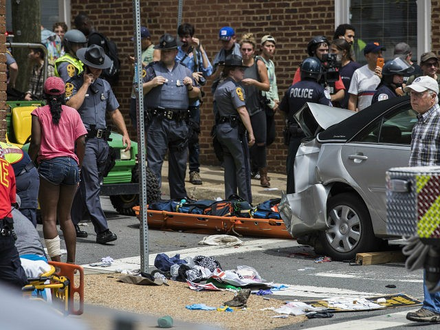 CHARLOTTESVILLE, USA - August 12: Police, medical personnel, and other protestors attend to the injured people after a car rammed into a crowd of anti-White Supremacy protestors in Charlottesville, Va., USA on August 12, 2017. (Photo by Samuel Corum/Anadolu Agency/Getty Images)