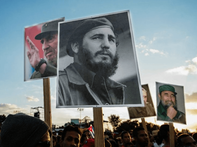 Cubans pay their respects to late revolutionary leader Fidel Castro during a ceremony in Santiago, on December 3, 2016