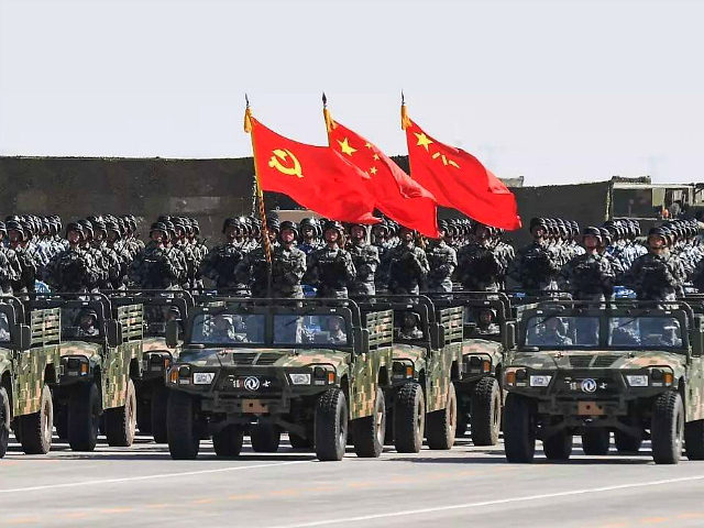 XILINGOL, CHINA - JULY 30: The flag guard formation holding the flag of the Communist Party of China, the national flag and the flag of the PLA attends a military parade at Zhurihe military training base to mark the 90th birthday of Chinese People's Liberation Army (PLA) on July 30, …