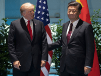 U.S. President Donald Trump, left, and China's President Xi Jinping arrive for a meeting on the sidelines of the G-20 Summit in Hamburg, Germany.