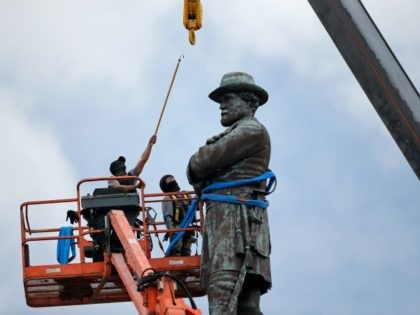 FILE- In this May 19, 2017, file photo, workers prepare to take down the statue of former Confederate general Robert E. Lee, which stands over 100 feet tall, in Lee Circle in New Orleans. Hanceville Mayor Kenneth Nail wrote to New Orleans Mayor Mitch Landrieu, asking him and city leaders …