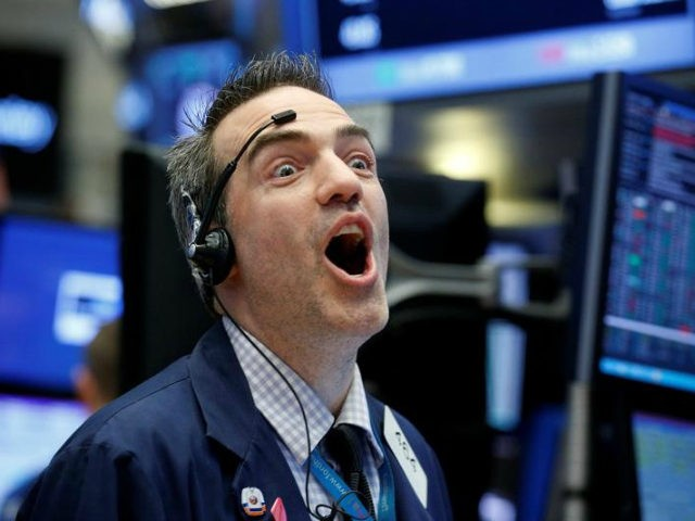 Man reacts to Dow Jones hitting 22,000 for first time in history Wednesday, August 2, 2017.