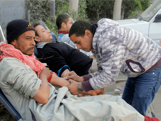 Egyptians donate their blood at a hospital following a train crash in Badrasheen, 40 KM South Cairo, Egypt, Tuesday, Jan. 15, 2013. At least 19 people died and more than 100 were injured when two railroad passenger cars derailed just south of Cairo, health officials say. The accident comes less …