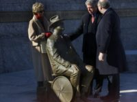 President Clinton views the new statue of Franklin Delano Roosevelt with two of Roosevelt's grandchildren Ann Roosevelt, left and Jim Roosevelt, right, at the dedication ceremony for the new prologue to the FDR Memorial in Washington, Thursday, January 10, 2001. The new statue depicts the disable president in his wheelchair. …