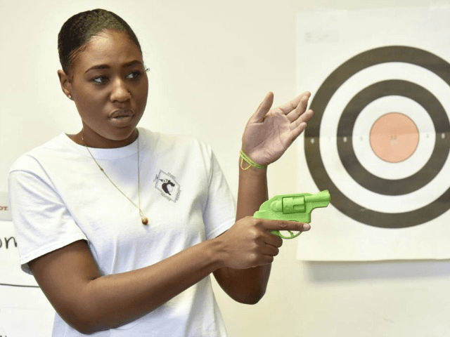 Black women picking up firearms for self-defense Photo