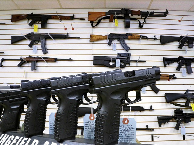FILE - In this Jan. 16, 2013 file photo, assault weapons and handguns are seen for sale at Capitol City Arms Supply in Springfield, Ill. In a questionnaire for The Associated Press, the four GOP candidates for governor, state Sens. Bill Brady and Kirk Dillard, state Treasurer Dan Rutherford and businessman Bruce Rauner disagree on whether assault-style weapons should be banned. They also disagree on whether to support a measure creating minimum prison sentences for gun crimes.Mississippi (AP Photo/Seth Perlman, File)