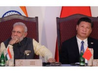Indian Prime Minister Narendra Modi, left, and Chinese President Xi Jinping listen to a speech during the BRICS Leaders Meeting with the BRICS Business Council in Goa, India, Sunday, Oct. 16, 2016. Brazil, Russia, India, China and South Africa, or BRICS, face the tough task of asserting their growing influence …