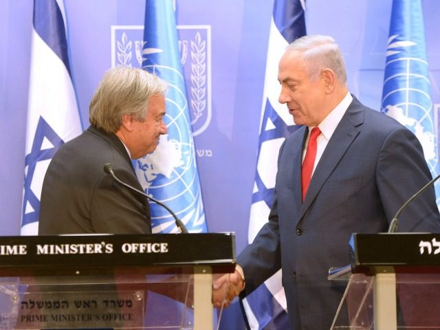 In this handout photo provided by the Israel Government Press Office (GPO), Israel's Prime Minister Benjamin Netanyahu (R) shakes hands with United Nations Secretary General Antonio Guterres on August 28, 2017 in Jerusalem, Israel. The UN Secretary General is on a four-day visit to Israel, his first visit since taking …