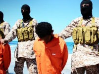 An image grab taken on April 19, 2015 from a video reportedly released by the Islamic State (IS) group through Al-Furqan Media, one of the Jihadist platforms used by the militant organisation on the web, purportedly shows men described as Ethiopian Christians captured in Libya kneeling on the ground in front of masked militants before their beheading on a beach at an undisclosed location in Libya. The video released online purportedly shows the executions of 30 Ethiopian Christians captured in Libya, with the footage showing one group of about 12 men being beheaded by militants on a beach and another group of at least 16 being shot in the head in a desert area. AFP PHOTO / HO / AL-FURQAN MEDIA == RESTRICTED TO EDITORIAL USE - MANDATORY CREDIT