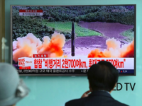 People watch a television news screen showing file footage of a North Korean missile launch, at a railway station in Seoul on August 29, 2017. Nuclear-armed North Korea fired a ballistic missile over Japan and into the Pacific Ocean on August 29 amid tensions over its weapons ambitions