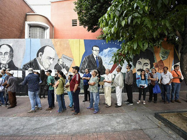 Voters wait in line to cast their ballots at the Andres Bello High School polling center during the elections for a constituent assembly in downtown Caracas, Venezuela, on Sunday, July 30, 2017. This vote, which was convened by President Nicolas Maduro, is the first step in a potential overhaul of the country's constitution which threatens to upend six decades of democracy in the oil-producing nation. Photographer: Carlos Becerra/Bloomberg via Getty Images