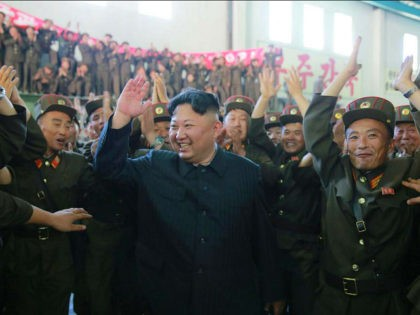 This picture taken on July 4, 2017 and released from North Korea's official Korean Central News Agency (KCNA) on July 5, 2017 shows North Korean leader Kim Jong-Un (C) celebrating the successful test-fire of the intercontinental ballistic missile Hwasong-14 at an undisclosed location. South Korea and the United States fired …