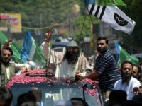 Senior leader of Kashmiri militant group Hizb-ul-Mujahideen Syed Salahuddin gestures as he arrives for a press briefing in Muzaffarabad on July 1, 2017. Pakistan June 27 strongly criticised the US decision to impose sanctions on Syed Salahuddin, senior leader of the Kashmiri militant group Hizb-ul-Mujahideen. 'The designation of individuals supporting the Kashmiri right to self-determination as terrorists is completely unjustified,' the foreign office said in a statement. / AFP PHOTO / SAJJAD QAYYUM (Photo credit should read SAJJAD QAYYUM/AFP/Getty Images)