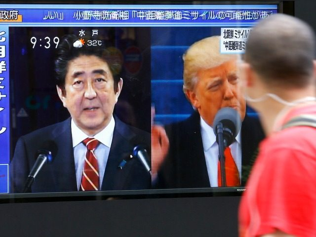 A man looks at a TV news program reporting North Korea's missile launch, in Tokyo, Tuesday, Aug. 29, 2017. North Korea fired a ballistic missile from its capital Pyongyang that flew over Japan before plunging into the northern Pacific Ocean, officials said Tuesday, an aggressive test-flight over the territory of …