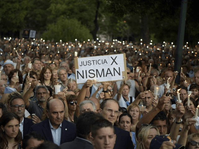 People hold candles during a vigil on the first anniversary of Argentinian prosecutor Alberto Nisman's mysterious death in Buenos Aires, on January 18, 2016. The prosecutor died in mysterious circumstances in January 18, 2015, after accusing Argentina's then president, Cristina Fernandez de Kirchner, of obstructing his investigation of a 1994 …