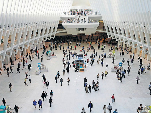 "In this Thursday, June 15, 2017, photo, people walk inside the Oculus, the new transit station at the World Trade Center in New York. Researchers are gearing up to start recruiting 10,000 New Yorkers early next year for a study so sweeping it's called ""The Human Project."" They'll be asked to share a trove of personal information, from cellphone locations and credit-card swipes to blood samples and life-changing events. For 20 years. The idea is to channel different data streams into a river of insight on health, aging, education and many other aspects of human life. (AP Photo/Frank Franklin II)"