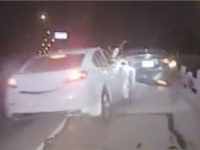 A car slammed into Texas police officer Matt Lesell as he approached a vehicle he pulled over for a routine traffic stop, according to newly released dashcam footage of the incident. He got up a few seconds later.