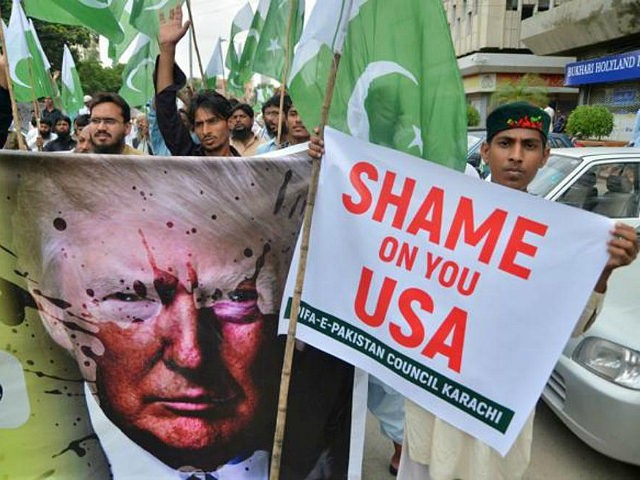 Supporters of Defence of Pakistan Council, a coalition of around 40 religious and political parties, carry banners during a protest against US President Donald Trump in Karachi on August 25, 2017. Angry and offended Pakistanis fired back against Donald Trump's accusations that their country harbours militants, highlighting the heavy toll …