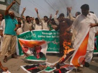 Pakistani protesters burn pictures of U.S. President Donald Trump and Indian Prime Minister Narendra Modi, in Sultan, Pakistan, Wednesday, Aug. 23, 2017. The U.S. ambassador to Pakistan David Hale met with Gen. Qamar Javed Bajwa Pakistan's army chief two days after President Donald Trump warned Pakistan to stop harboring insurgents …