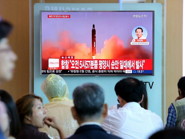 People watch a TV screen showing a file footage of North Korea's missile launch, at the Seoul Railway Station in Seoul, South Korea, Tuesday, Aug. 29, 2017. North Korea fired a ballistic missile from its capital Pyongyang that flew over Japan before plunging into the northern Pacific Ocean, officials said …