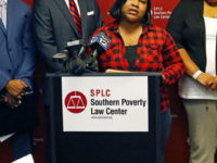 Dorothy Haymer of Yazoo City, at podium, Indigo Williams, left and Precious Hughes, right. both of Jackson, explains the reasons as African-American mothers of children in public elementary schools, they are plaintiffs in a Mississippi education lawsuit filed on her behalf, by the Southern Poverty Law Center, SPLC, Tuesday, May 23, 2017, in Jackson, Miss. Mississippi is denying good schools to African American students and violating the federal law that enabled the state to rejoin the union after the Civil War, the Southern Poverty Law Center alleged Tuesday in a lawsuit trying to strengthen constitutional protections for education. (AP Photo/Rogelio V. Solis)