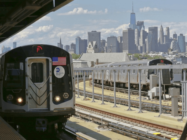 FILE – In this June 21, 2017 file photo, a subway train approaches the platform at Brooklyn's Smith Street above-ground subway station, in New York. Mayor Bill de Blasio wants to tax the wealthiest 1 percent of New Yorkers to fund repairs and improvements to the beleaguered subway system. The …