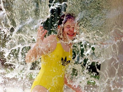 Twelve-year-old Jennifer (no surmane available) takes a shower at the open air municipal swimming pool in Duesseldorf, western Germany, Monday, May 8, 2000. Germany is enjoying warm and sunny weather with temperatures up to 28 degrees Celsius (82 degrees Farenhiet) during the past few days. The weather forecast predicts a …