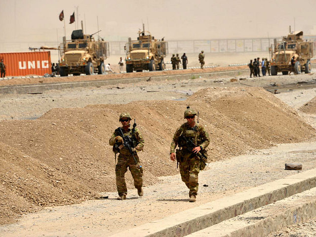 US soldiers walk at the site of a Taliban suicide attack in Kandahar on August 2, 2017. A Taliban suicide bomber on August 2 rammed a vehicle filled with explosives into a convoy of foreign forces in Afghanistan's restive southern province of Kandahar, causing casualties, officials said. 'At around noon a car bomb targeted a convoy of foreign forces in the Daman area of Kandahar,' provincial police spokesman Zia Durrani told AFP. / AFP PHOTO / JAVED TANVEER (Photo credit should read JAVED TANVEER/AFP/Getty Images)