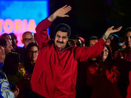 Venezuelan president Nicolas Maduro celebrates the results of 'Constituent Assembly', in Caracas, on July 31, 2017. Deadly violence erupted around the controversial vote, with a candidate to the all-powerful body being elected shot dead and troops firing weapons to clear protesters in Caracas and elsewhere. / AFP PHOTO / RONALDO …