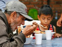 Venezuelans get food at the Casa de Paso Divina Providencia refuge in Cucuta, Colombia on July 31, 2017. The United States, Mexico, Colombia, Peru and other nations said they did not recognize the results of the election Sunday of a new 'Constituent Assembly' superseding Venezuela's legislative body, the opposition-controlled National Assembly. / AFP PHOTO / SCHNEYDER MENDOZA (Photo credit should read SCHNEYDER MENDOZA/AFP/Getty Images)