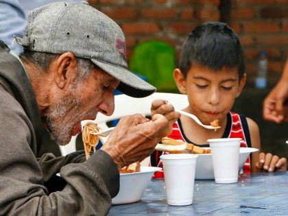 Venezuelans get food at the Casa de Paso Divina Providencia refuge in Cucuta, Colombia on July 31, 2017. The United States, Mexico, Colombia, Peru and other nations said they did not recognize the results of the election Sunday of a new 'Constituent Assembly' superseding Venezuela's legislative body, the opposition-controlled National …