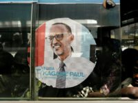 A bus is adorned with an image of incumbent Rwandan President Paul Kagame, expected to win a third election term in Friday's poll
