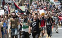 Protesters march in Charlottesville, Virginia on August 12, 2017