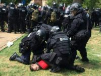 In this twitter hand-out photo courtesy of the Virginia State Police, arrests are being made following the declaration of unlawful assembly at Emancipation Park in Charlottesville, Virginia on August 12, 2017