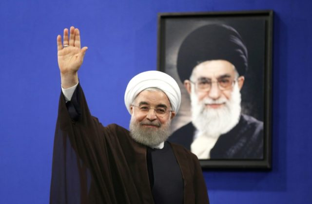 Newly re-elected Iranian President Hassan Rouhani gestures after delivering a televised speech in the capital Tehran on May 20, 2017