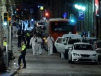 Forensic policemen arrive in the cordoned off area on Las Ramblas in Barcelona on August 17, 2017 after a van ploughed into the crowd, killing 13 people and injuring over 80