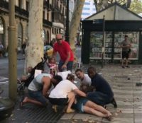 This video grab obtained from the instagram account carlos_tg_32_ shows people tending to an injured woman after a van ploughed into the crowd on Barcelona's popular Las Ramblas boulevard.