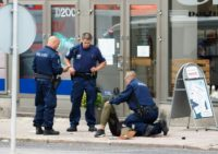 Finnish police detain a suspect who was shot in the leg after several people were stabbed in Turku on August 18, 2017