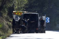 Explosives experts move in check to the site where Younes Abouyaaqoub was shot on Monday, four days after he allegedly plughed a van down Las Ramblas in Barcelona, killing 13 people