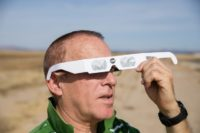 Martin Ferreira, a total eclipse enthusiast, tries out protective eyewear while waiting out standstill traffic near Madras, Oregon -- one of the first places the eclipse will be visible