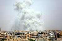 This file picture shows smoke billowing out from the Syrian city of Raqa following a coalition air strike on July 28, 2017