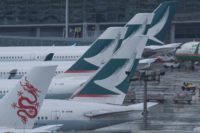 Flag carrier Cathay Pacific said almost all its flights between 6:00 am and 5:00 pm local time Wednesday would be axed.