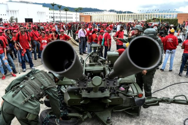 Members of Venezuela's army show civilians how to handle an anti-aircraft battery during military drills