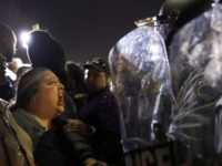 FILE - In this Aug. 11, 2014 file photo, a protester yells at police outside the Ferguson, Mo., Police Department while participating in a rally against the shooting of 18-year-old Michael Brown. Filmmakers will join the national conversation about race, policing and social protest this week in Philadelphia. The sixth …
