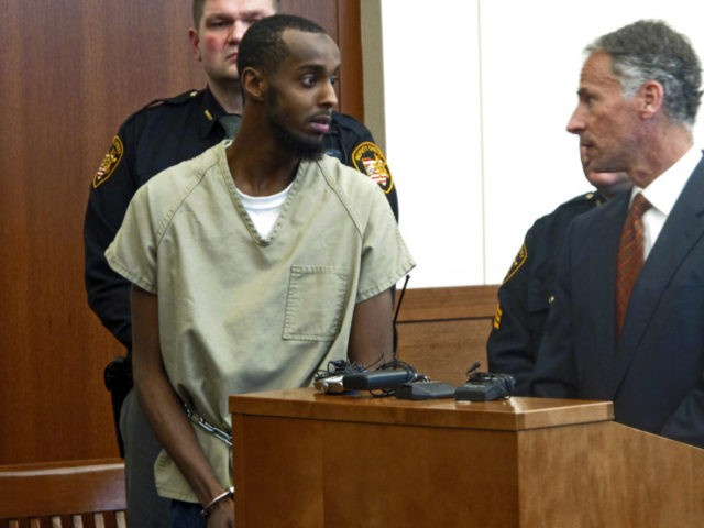 FILE – In this Feb. 25, 2015, file photo, Abdirahman Sheik Mohamud, front left, speaks with his attorney Sam Shamansky, right, during a hearing to set bond in Columbus, Ohio. Mohamud pleaded guilty to terrorism charges in 2015 and is asking for leniency at his scheduled sentencing Friday, Aug. 18, …